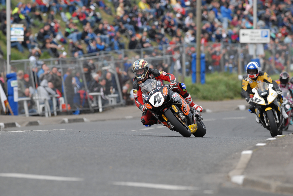 John McGuinness leads Keith Amor at Church Corner NW200