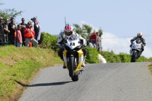 Adrian Archibald in front of the late Andrew Neil skerries 100
