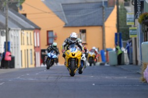 Dean Harrison leads David Yeomans and Alan Bonner through the narrow streets of Dunmanway at the 2010 Munster 100