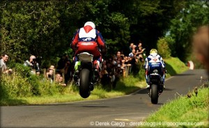 Michael Dunlop (MD Honda) gets big air as he chases down Tyco Suzuki's Guy Martin at the 2013 Armoy road races. Photo © Derek Clegg. All rights reserved.